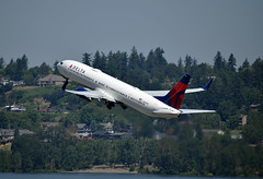 Delta Air Lines Boeing 737-932(ER)(WL) (zfwaviation) Tags: kpdx pdx portland oregon or airport aviation internationalairport intl airplanes planes plane airlines spring international n859dn delta dl boeing 737900 737 boat tug grain columbia river grass airplane tree forest landscape building