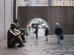 Waterfall Glass Tube Tunnel Midtown Manhattan 0414 (Brechtbug) Tags: waterfall glass tube tunnel midtown manhattan 48th street between 6th 7th avenues park half way through city block paparazzi dogman rabbitgirl sculptures by artists gillie marc bronze art statues characters new york water autumn walk wall bridge bridges tunnels 2018 nyc 04272018 fall falls dog rabbit bunny canine suit suits cameras camera