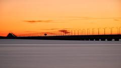 After the sunset (Explore) (Cajofavi) Tags: bridge ölandsbron öland sweden dusk water sky sea lighttrail
