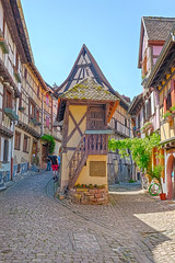 Medieval town (enneafive) Tags: france eguisheim alsace medieval town vines timberframing sky blue remparts historic fujifilm xt2 colours roofs houses streets wood bikes hdr