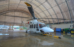 Herd Base Hanger (Andy.Gocher) Tags: andygocher canon100d papuanewguinea herdbase hanger helicopter aw139 hevilift leonardo agusta westland helicopters png reflection goodrich rescue hoist
