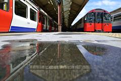 Wet reflections at Baron's Court Station (Luke Agbaimoni (last rounds)) Tags: london londonunderground londontube train transportforlondon reflection reflect reflections rain