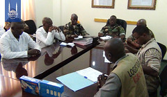 IR staff meeting with doctors and officials at a treatment centre.jpg