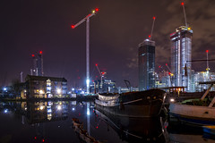 Cranes (cliveg004) Tags: canarywharf blackwallbasin millwall docklands towers lights city cityscape boats barges thamesbarge cranes reflections water docks london night dark nikon d5200