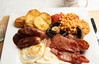 _DSC5283 (BobPetUK) Tags: breakfast fry fried fryup sausage sausages meal egg eggs bacon friedpotatoes potatoes potatowedges beans mushrooms bakedbeans cooking morning plate protein nutrition nutritious