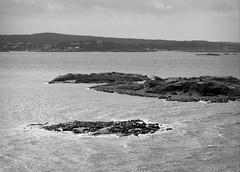 Piece of rock (p2-r2) Tags: nikon f3 f3hp gothenburg sweden blackandwhite agfa apx 100 new emulsion film sea water ship boat ferry rocks islands