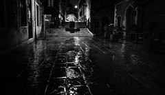 Don't look now (Frank Busch) Tags: daphnedumaurier frankbusch frankbuschphotography bw blackwhite blackandwhite italy man monochrome pavement rain reflections suspence thriller umbrella venice wetpavement wwwfrankbuschname