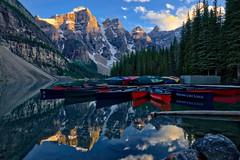 Abandoned in the creative wilderness (Jim Nix / Nomadic Pursuits) Tags: jimnix nomadicpursuits travel canada canadianrockies morainelake sunset hdr canoes boats lake reflection aurorahdr2018 luminar2018 macphun skylum sony sonya7ii glacial glacier lightroom