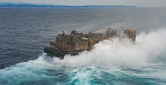 """A landing craft air cushion exits the well deck of the USS Wasp during a routine patrol in the Indo-Pacific (#PACOM) Tags: usswasp sailors lcac usswasplhd1 sasebo japan """"uspacificcommand pacom"""""""
