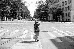 The Lookout 240.365 (ewitsoe) Tags: canon city spring street warszawa erikwitsoe poland streetphotography urban warsaw lady middle road looking hands hot summer feel vibe warmspring ochota tram stop mono monchrome blaackandwhite