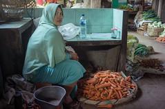 (kuuan) Tags: solo surakarta java indonesia mf minolta rokkor mrokkorf240mm leica f2 40mm 240 f240mm minoltamrokkor mrokkor apsc nex5n portrait street market bazaar pasar pasarlegi stall women marketstall carrots muslim hijab eyes eyecontact