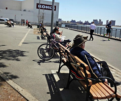 Just Like Summer (Robert S. Photography) Tags: bench people sitting relaxing walking running waterfront spring hot nyc brooklyn caesarsbay sony dscwx150 iso100 may 2018