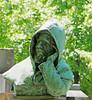 Hooded man, hand to head, pondering (Monceau) Tags: hooded man hand head pondering thinking sparkling bokeh