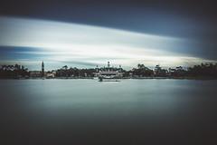the world showcase lagoon (Eddy Alvarez) Tags: epcot long exposure nikon disney clouds time lake smooth worldshowcase travel countries vacation florida destination waltdisneyworld