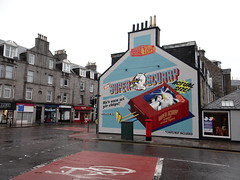 Rainy day humour (Ian Robin Jackson) Tags: rain nuart aberdeen rainy scotland scottish city art granite road shops