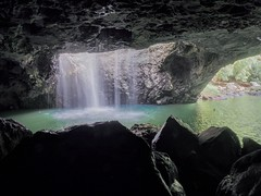 From cave and plunge pool to outside (Lesmacphotos) Tags: waterfall qld australia tourist tourism tour holiday nationalpark nature water discoveraustralia