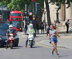 Trafalgar Square Runner (Waterford_Man) Tags: run runner running jog jogger jogging shorts girl people path london candid street