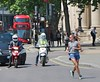Trafalgar Square Runner (Waterford_Man) Tags: run runner running jog jogger jogging shorts girl people path london candid street