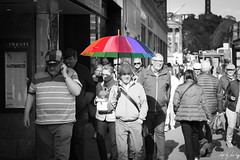 Twenty Shades Of Grey (Cycling Road Hog 2018) Tags: blackwhite candid canoneos750d cap colour ef50mmf18stm edinburgh edinburghstreetphotography hat lady man monochrome niftyfifty scotland street streetphotography streetportrait style umbrella