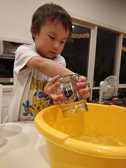 Liam tipping water out of the jar (avlxyz) Tags: liam lfb science water