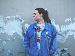 Miriam (livsillusjoner) Tags: jeans jeansjacket brunette outside outdoor norge tromsø troms wall grey blue white stripes black pale portrait people
