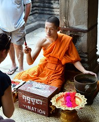 Buddhist Monk in Angkor Wat Temple, Cambodia. (One more shot Rog) Tags: buddhist monks monk buddhistmonks angkor cambodia temple worship prey robe offering angkorwat angkorwattemple angkorthom