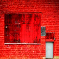 a red brick wall in the colour of a brick-red crayola (wacky doodler) Tags: door city red urban detroit roadtrip warehouse motown wackydoodler