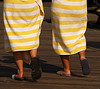 stripey bottoms (dlemieux) Tags: life city light summer people urban newyork texture feet beach colors yellow brooklyn walking coneyisland twins legs stripes citylife dlemieux dianalemieux august towel 2006 flipflops boardwalk towels borough bklyn matching colourful insync streetsmilecontest2