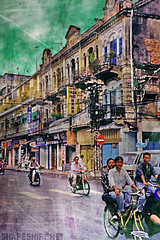 the nature of bikes (shapeshift) Tags: saigon travel bikes bicycles motorbikes colonial architecture texture bluelist hochiminhcity asians southvietnam orient theorient asia southeastasia street streetphotography asian asianamerican asianamericans aplusphoto flickrhearts theothervillage shiningstar vietnamese thetinker vietnam indochina buildings davidpham shapeshift davidphamsf 1998 transportation transport shapeshiftnet documentary