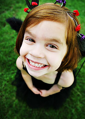 Cheese! ({amanda}) Tags: distortion colour girl smile cheese fun happy kid wings funny child teeth perspective grin blackdress 18mm fouryears blackwings impressedbeauty amandakeeysphotography eliteimages