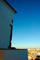 Leaning over the city (pmsmgomes) Tags: blue sky building slr portugal colors wall digital nikon view d70s perspective setúbal leaning pmsmgomes overthecity