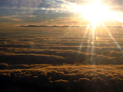 Cloud tops (Roo Reynolds) Tags: sunset sky cloud sun plane glare zurich flight coulds