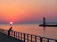 Manistee Lighthouse Sunset (Jeremy Stockwell) Tags: pink sunset sea sky lighthouse lake water seaside still fishing quiet peace silent michigan peaceful calm lakeside lakemichigan silence photofriday hush stillness manistee canonpowershots1is farfromhome jeremystockwellpix twtmewpcjs photofridayfarfromhome