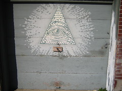 Eye of Providence (rick) Tags: sanfrancisco door wood eye handle wooden triangle pyramid lock garage 2006 vai padlock foundinsf garagedoor stevevai eyeofgod eyeofprovidence gwsf