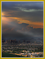Eerie Light Over Phoenix (jimhankey) Tags: sunset arizona sky cloud sun mountain storm mountains phoenix beautiful topv2222 skyline clouds plane wow airplane landscape gold interestingness bravo skyscrapers desert topv1111 topc50 scenic parks naturallight explore corona valley citylights vista orangesky moonlight redsky downtownphoenix goldensunset dramaticsky beautifulclouds sunray cirrus eveninglight phoenixarizona stormyweather beautifulscenery afternoonlight redsunset southmountain phoenixaz cumulous scenicview helluva desertmountain eerielight goldensky blueribbonwinner loomingsky unusuallight loweringsky glowingcloud canonpowershots3is loomingcloud seeninexplore menacingcloud listedinexplore impressedbeauty jimhankey lovelycity diamondclassphotographer flickrdiamond phoenixariz