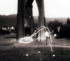 flaming paper airplanes and the fourth dimension (manyfires) Tags: longexposure blackandwhite bw oregon portland pentax k1000 stjohns pdx cathedralpark