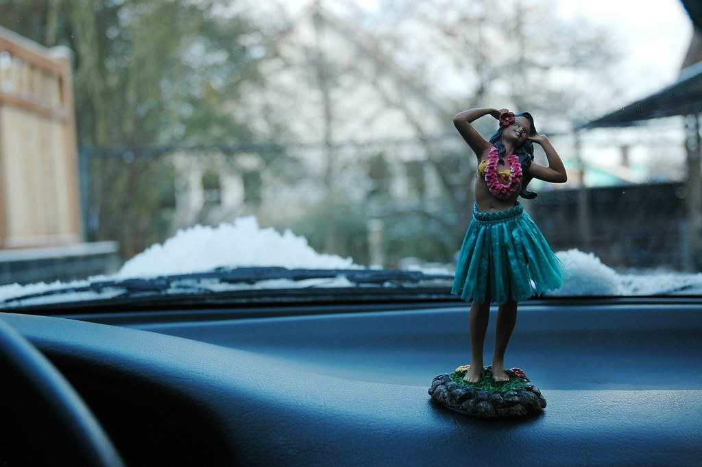 Island dancer on the dashboard of my NX by Wonderlane, on Flickr