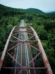 Showashinzan (Gai) Tags:    toya hokkaido japan   summer  countryside  mountain  green  tree  natural  bridge  road  car   cloudy