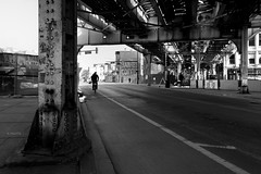 Clark and Roscoe (Andy Marfia) Tags: chicago lakeview cta el l elevated trains redline street cyclist cycling buildings demolition ghostsign blackandwhite bw d7100 1685mm 180sec f5 iso100