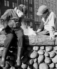 Major Arson (theirhistory) Tags: children kids boy wall rocks stones cap jacket fire trousers wellies rubberboots