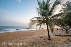 People mill about on the beach looking out into the waves Monrovia, Liberia (Remsberg Photos) Tags: beach tropical travel tourists landscape scenery scenic traveler africa developing liberia monrovia westafrica ocean waves surf sand water tide dusk sandy picturesque group enjoyment sunset