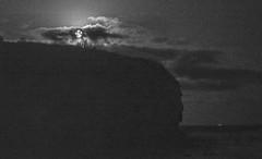 moon rising (grannie annie taggs) Tags: moon bw clouds headland