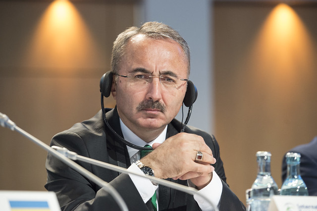 Yüksel Coşkunyürek listens to a speaker at the Closed Ministerial