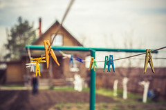 Clothespin on clothesline in the garden background bokeh (Sergey Lobkarev) Tags: background blue clothespin clothesline bright beautiful white rope colorful green line color closeup peg bokeh day garden isolated design nature red concept macro clip pin