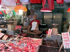 Surprised Butcher (cowyeow) Tags: meat butcher pig pork ham chinesefood china chinese asia hongkong kowloon food cantonesefood shamshuipo urban street man surprised funny candid shop city asian