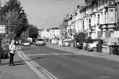 The queue at the bus stop, Mount Pleasant Road, Hastings. (tony allan tony allan) Tags: street revuenon lens manual focus blackandwhite people waiting