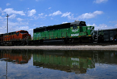 Cascade Reflections (Jeff Carlson_82) Tags: bnsf bn ks emd sd402 puddle reflection sewerpickle 1657 burlingtonnorthern cascadegreen topeka kansas yard train railroad railfan railway