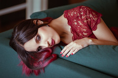One Of Those Days (CARECOM photography) Tags: red green couch sofa lounge thoughtful emotional lying hair woman female model sensual home indoor
