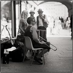 The young musician_Hasselblad (ksadjina) Tags: 10min 6x6 adoxaph09 austria carlzeisssonnar150mmf14 getreidegasse hasselblad500cm kodak400tmax musikanten nikonsupercoolscan9000ed salzburg silverfast analog blackwhite film scan