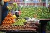 Lost in fruits. (Iftekhar Hasan) Tags: stree street streetphotography streetlife fruits shopkeeper orange green colors stilllife iftekharhasan